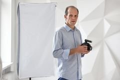 Young photographer in studio royalty free stock image