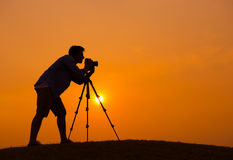 Young Photographer at Sunset Royalty Free Stock Image