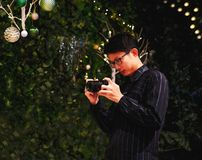 Young photographer take pictures on Christmas day. At night scene royalty free stock photo