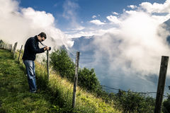 Young photographer is taking a picture in Norway Royalty Free Stock Photos