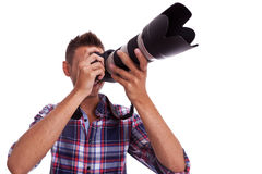 Young photographer taking pictures Stock Images
