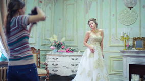 Young photographer is taking pictures the bride stock video footage