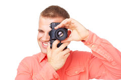 Young photographer taking pictures with his camera Royalty Free Stock Image