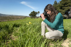 Young photographer taking pictures outdoors Stock Images