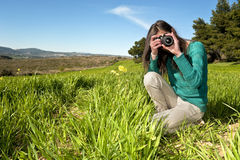Young photographer taking pictures outdoors Stock Photography