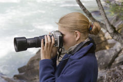 Young photographer with telephoto lens Royalty Free Stock Image
