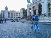 Young photographer with tripod in front of Sacre Coeur basilica on Montmartre in Paris, France Royalty Free Stock Photo