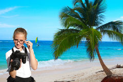 Young photographer and tropical palm Stock Photos