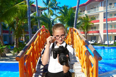 Young photographer and tropical resort Royalty Free Stock Photos