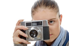 Young photographer woman with a vintage camera. A young photographer woman with a vintage camera Royalty Free Stock Image