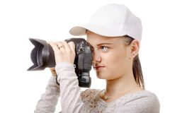 Young photographer woman with white cap Stock Photos