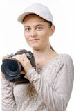Young photographer woman with white cap Stock Image
