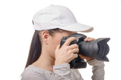 Young photographer woman with white cap isolated on white Royalty Free Stock Photography