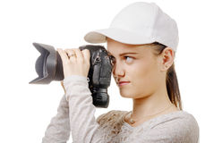 Young photographer woman with white cap isolated on white Stock Photo