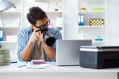The young photographer working with his camera. Young photographer working with his camera Royalty Free Stock Image