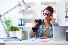 The young photographer working with his camera. Young photographer working with his camera Royalty Free Stock Photos