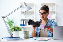 The young photographer working with his camera. Young photographer working with his camera Royalty Free Stock Photo