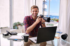Young photographer working from his home studio Royalty Free Stock Photos