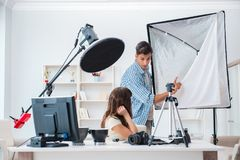 The young photographer working in photo studio Stock Images