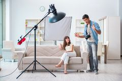 The young photographer working in photo studio Stock Photography