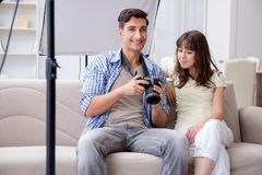 The young photographer working in photo studio Royalty Free Stock Images