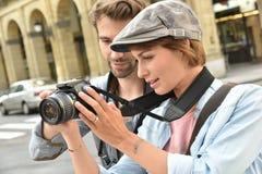 Young photographers doing photo reportage Stock Photos