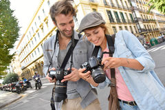 Young photographers doing reportage in the city Stock Image
