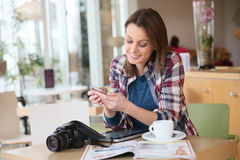 Young photography student on a smartphone Stock Photo