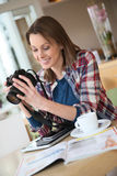 Young photography student working in the coffee shop Stock Photo