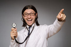 The young physician with stethoscope against gray Stock Photo