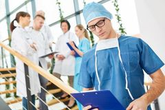 Young physician and surgeon. With intensive Care team Royalty Free Stock Photography