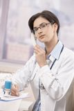 Young physician talking on phone Royalty Free Stock Images