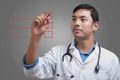 Young physician ticking the checklist Stock Images