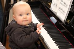 Really young pianist Stock Photography