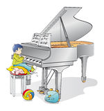 Young pianist. Infant musician learning to play the piano Stock Photos