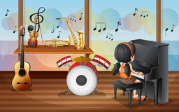A young pianist inside the music room Stock Images