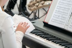 Young pianist studies the schedule before a performance stock photo
