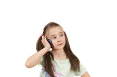 Young pig-tailed girl using mobile phone isolated Royalty Free Stock Photos