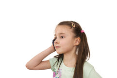 Young pig-tailed girl using mobile phone isolated Stock Images