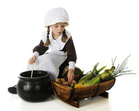 Young Pilgrim Cooking Stock Photo