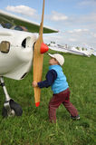 Young pilot. Little child, future young pilot, starting engine of an aircraft Royalty Free Stock Photo