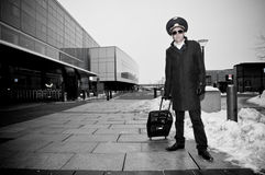 Young pilot with baggage in Kastrup airport Stock Photos