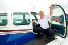 Young pilot with down syndrome at aircraft. Stock Images