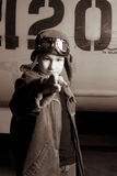 Young Pilot with flight goggles pointing at camera Stock Image