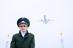 Young pilot with glasses and black coat Stock Images