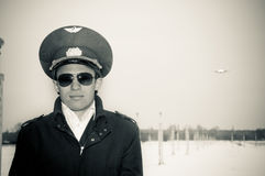 Young pilot with glasses and black coat, bw Stock Photo