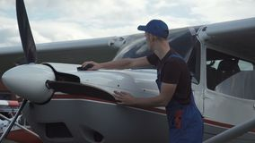 Young pilot or mechanic working on an aircraft stock video footage
