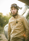Young pilot posing near the helicopter Stock Images