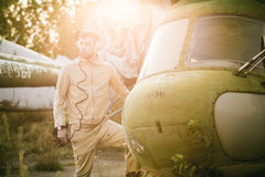 Young pilot posing near the helicopter Royalty Free Stock Photography