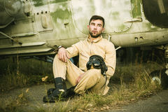 Young pilot posing near the helicopter Royalty Free Stock Photo